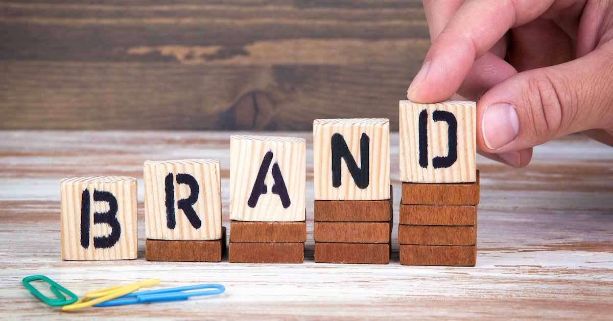 "spelling ""brand"" with lettered blocks to reinforce Your Brand Promise in Real Estate Marketing"