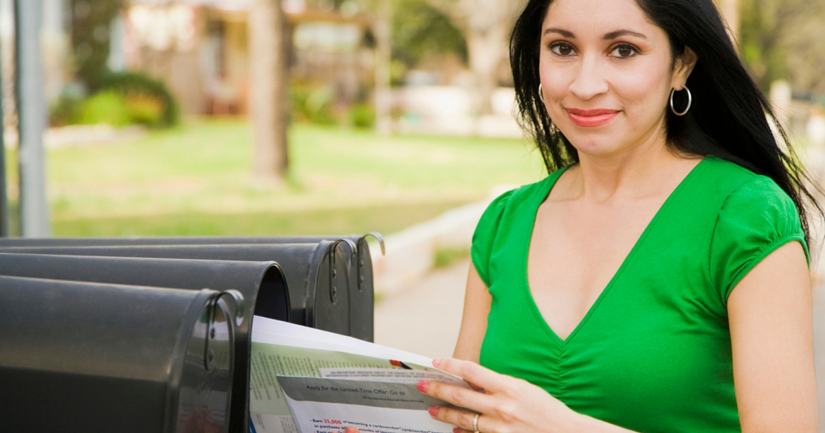 woman receiving her direct mail marketing campaign in march