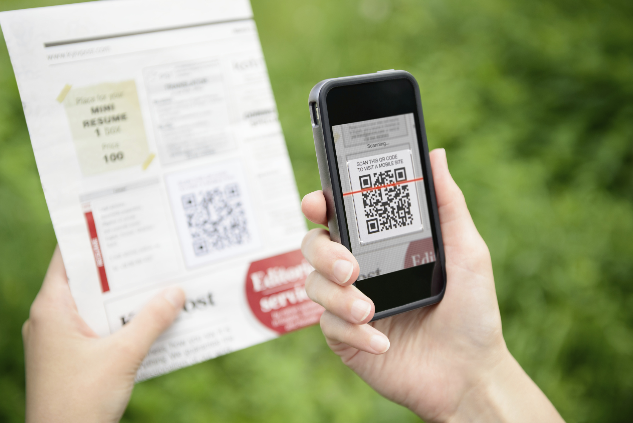home owner scanning a qr code on a postcard