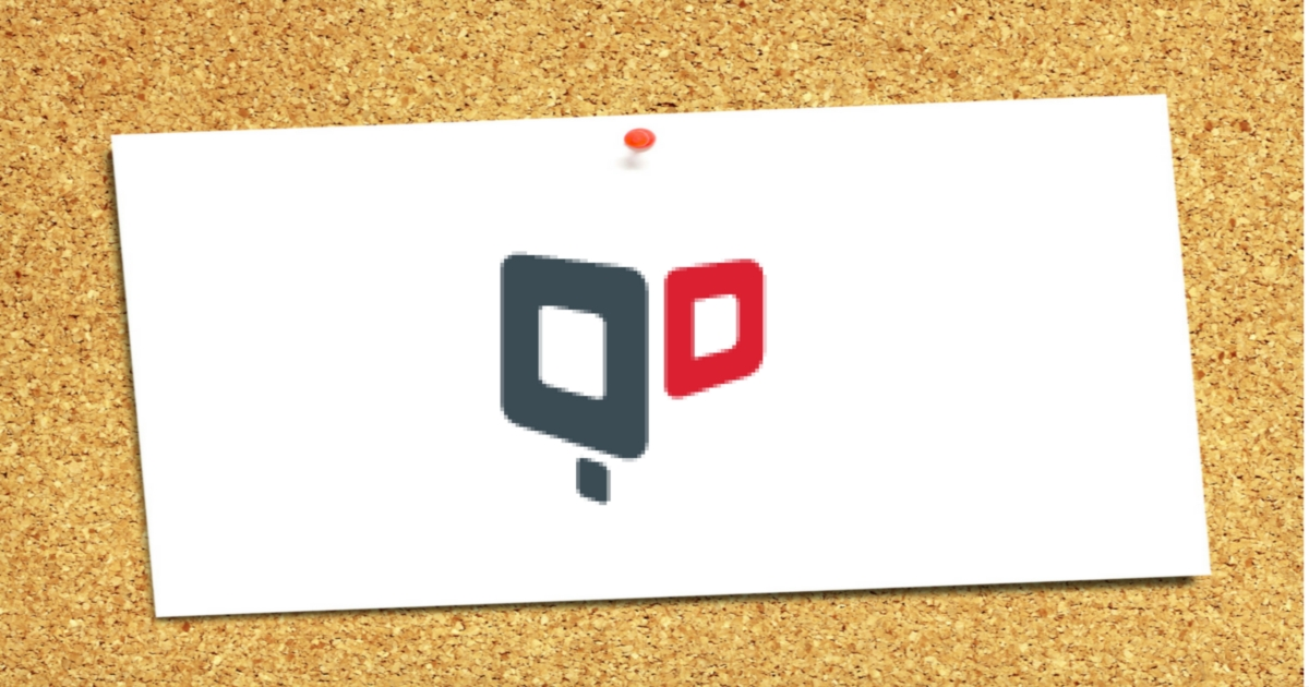a pinned quantumdigital logo on a cork board as a reminder