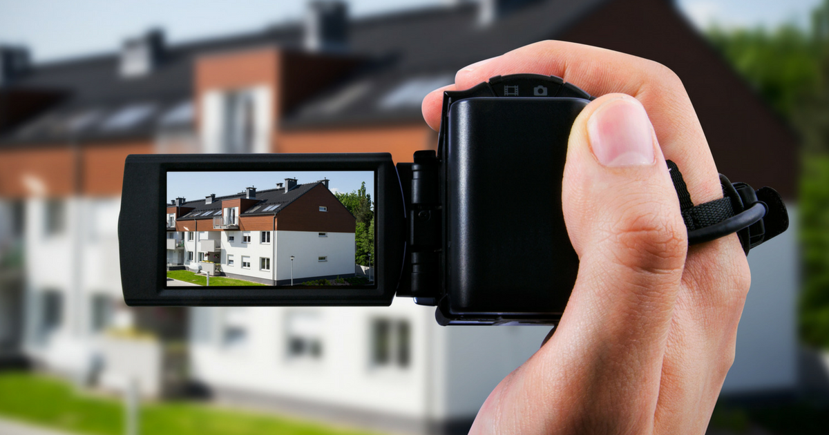 real estate agent creating a virtual tour of a property with a video camera